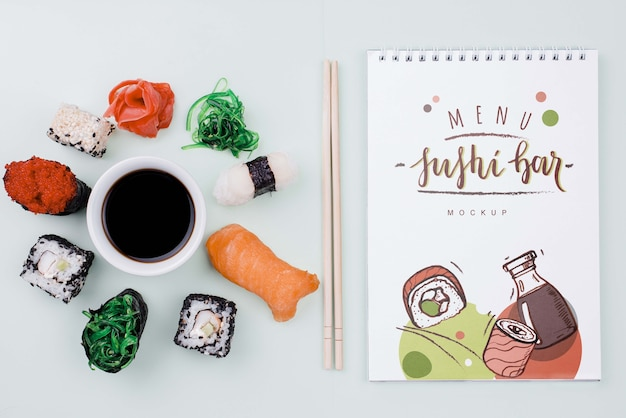 Mock-up sushi rolls with soya sauce and notebook