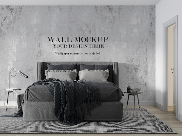 Mock up wall behind modern grey bed with minimalist furniture