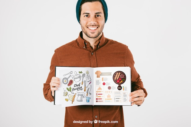 Mock up with happy man and open book Free Psd
