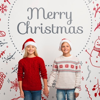 Mock-up young siblings with christmas sweaters