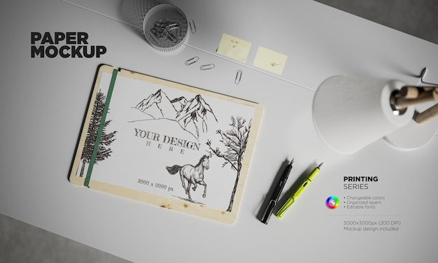 机の上に万年筆が付いたモックアップa4紙