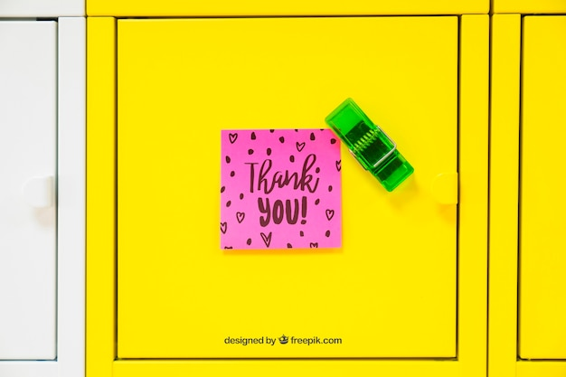 Mockup of adhesive note on yellow background