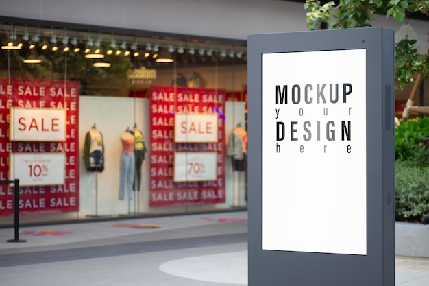 Mockup of advertisement lightbox with blurred fashion store