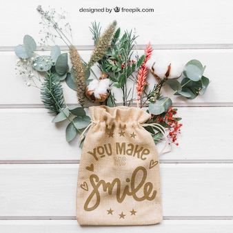 Mockup of bag on leaves and branches