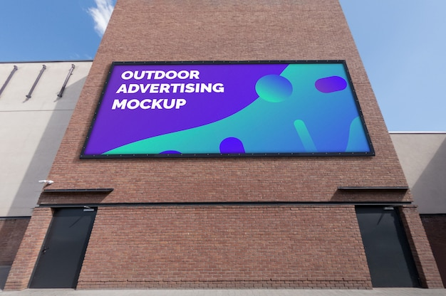 Mockup of big outdoor landscape billboard on brick wall