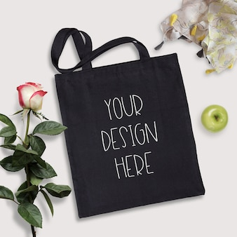 Mockup of black cotton tote bag, summer time scene