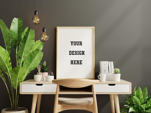 Mockup black frame on work table in living room interior on empty dark wall background,3d rendering