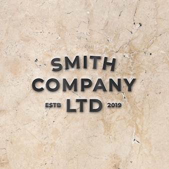 Mockup of black metallic 3d logo on bright stone marble wall