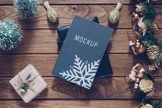 Mockup blank black book cover for christmas and new year background