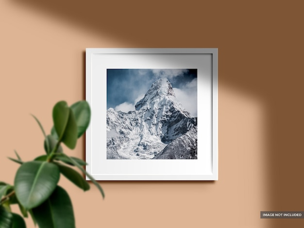 Mockup blank photo frame in color wall