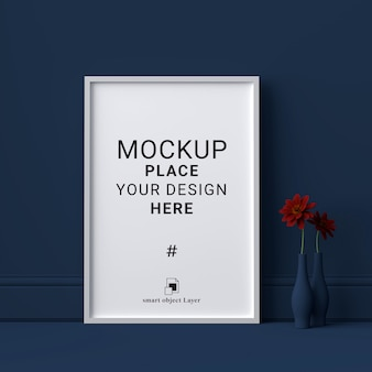 Mockup blank photo frame on dark blue wall