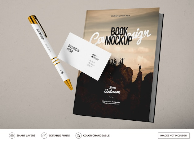Mockup of book with business card and pen design