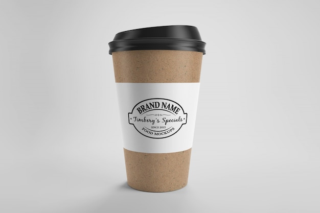 Mockup of brown paper eco coffee cup with cap and paper label