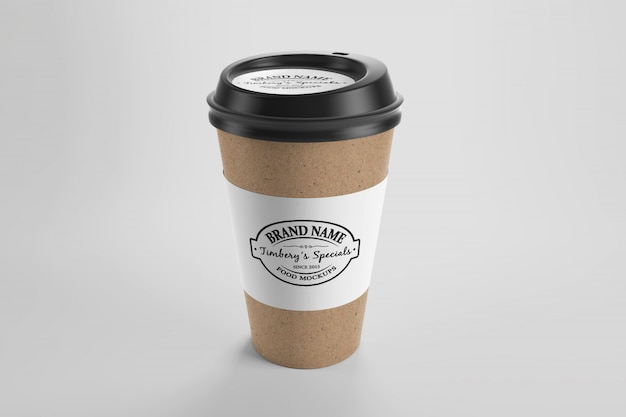 Mockup of brown paper eco coffee cup with sticker and cap