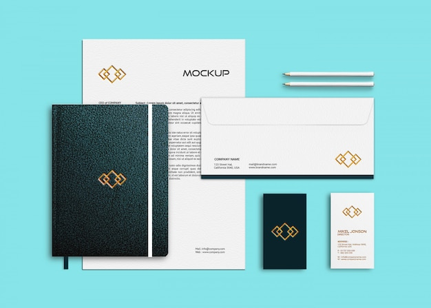 Mockup of business card, letterhead and notebook