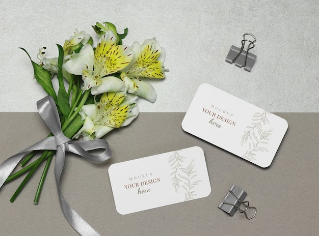 Mockup business card with flowers, ribbon on grey beige background