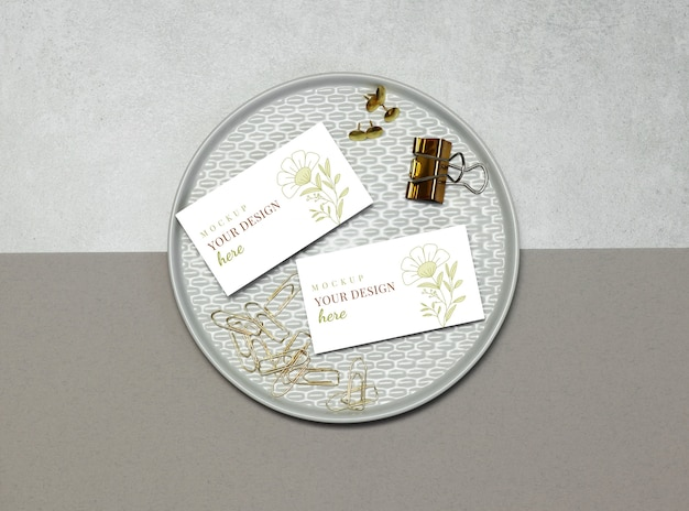Mockup business card with gold pins and clips