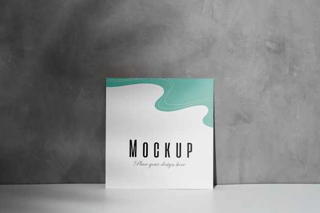 Mockup card leaning on the wall