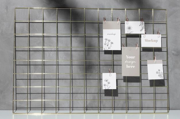 Mockup cards hanging on grid memo board