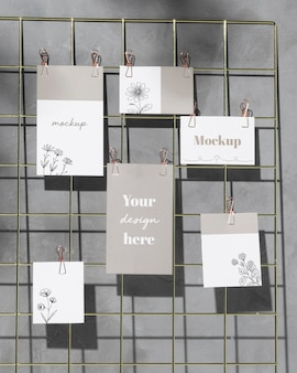 Mockup cards hanging on grid wire board