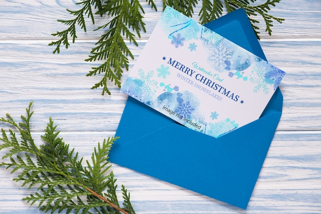 Mockup of christmas greeting card and fir branches