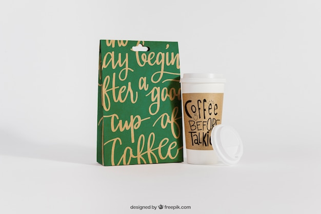 Mockup of coffee cup next to bag