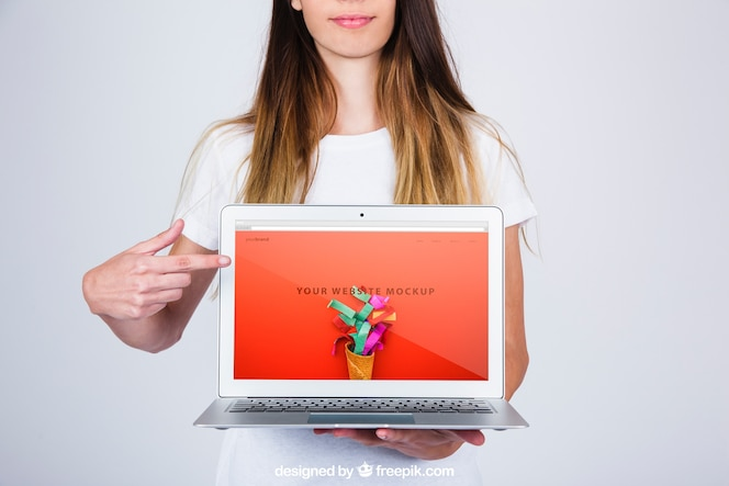 Mockup concept of woman presenting laptop