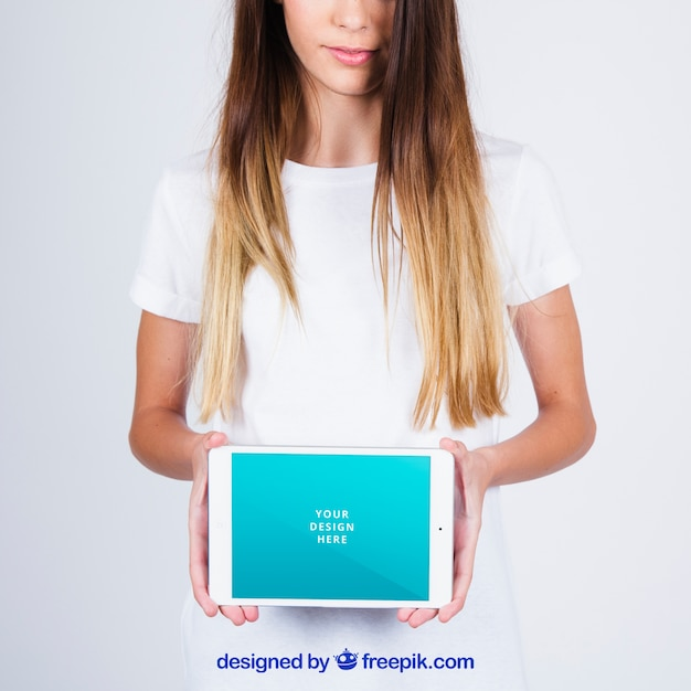 Mockup concept of woman showing tablet