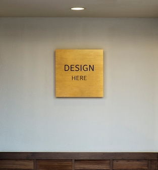 Mockup design here sign and picture frame and wall texture