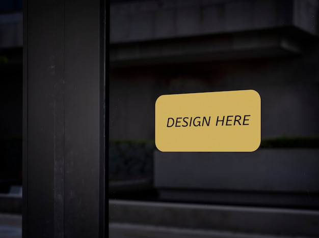 Mockup design here sign wooden door front view