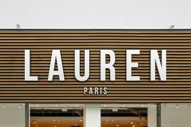 Mockup of exclusive elegant fashion 3d white logo sign on wooden shop facade or storefront entrance