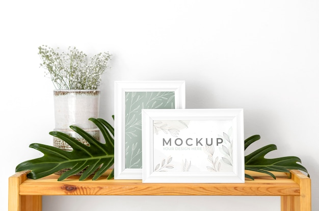 Mockup frame beside flowers
