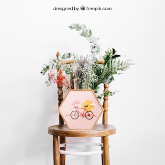 Mockup of frame on chair with flowers