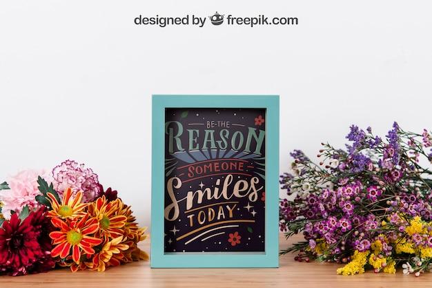 Mockup of frame between flowers Free Psd