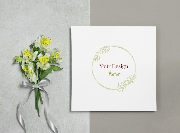 Mockup frame on grey beige background with bouquet of flowers