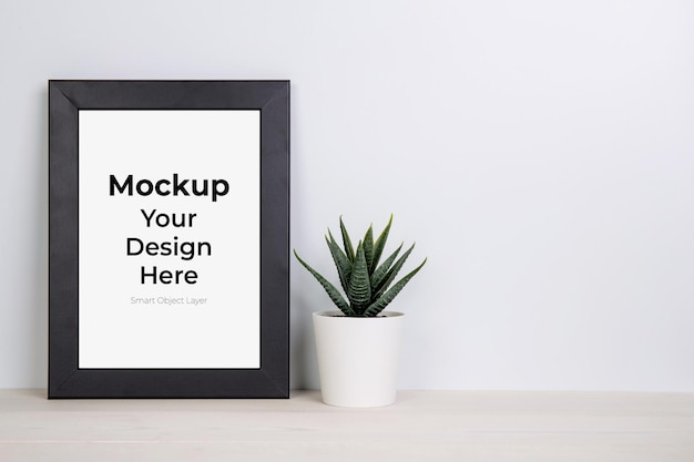 Mockup frame and plant in pot