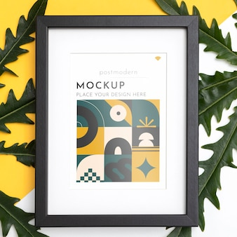 Mockup frame on wall with leaves