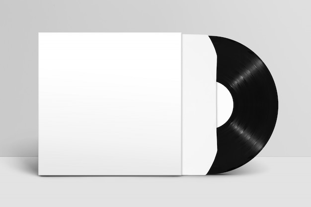 Mockup of front view standing blank vinyl record with cover and sleeve against white wall