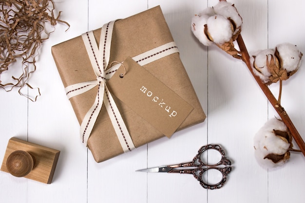 Mockup of a gift box in craft paper with tag