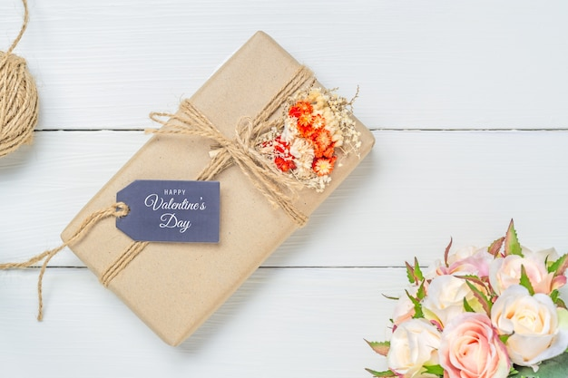 Mockup gift tag and kraft gift boxe for valentine's day concept.