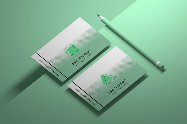 Mockup of green business cards with pencil