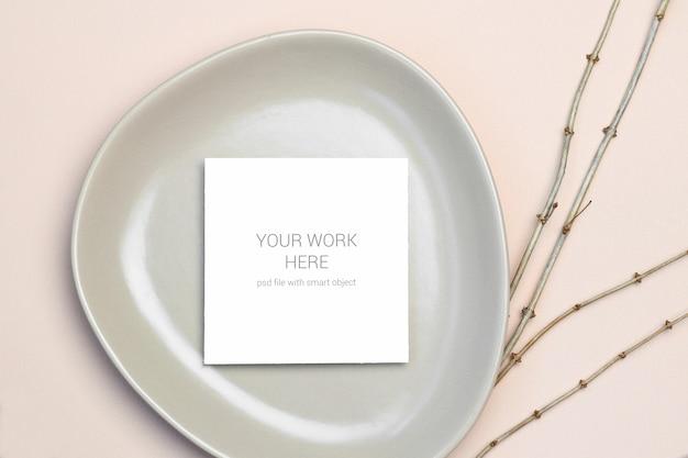 Mockup greeting card on plate