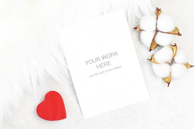 Mockup greeting card with cotton on furry background