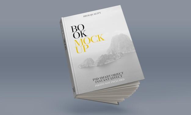 Mockup di un libro semiaperto che galleggia su uno sfondo blu