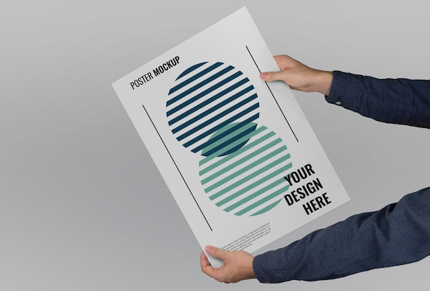 Mockup of hands holding a large-format poster on a flat background