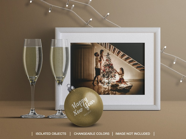 Mockup of holiday card frame and christmas ball with champagne glasses decoration