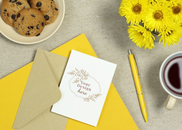 Mockup holiday card with yellow notes, pen and summer flowers