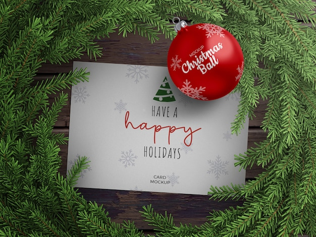 Mockup of holiday greeting card and christmas ball with wreath decoration
