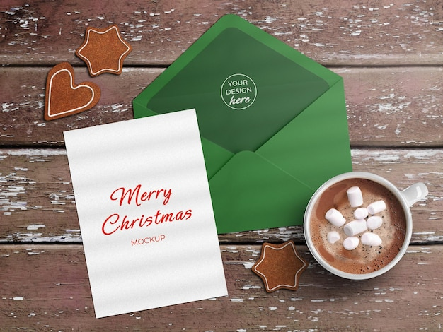 Mockup of holiday greeting card flyer and envelope with christmas decoration flat lay isolated