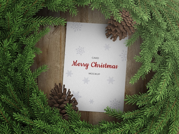Mockup of holiday greeting card flyer with christmas wreath decoration with cones
